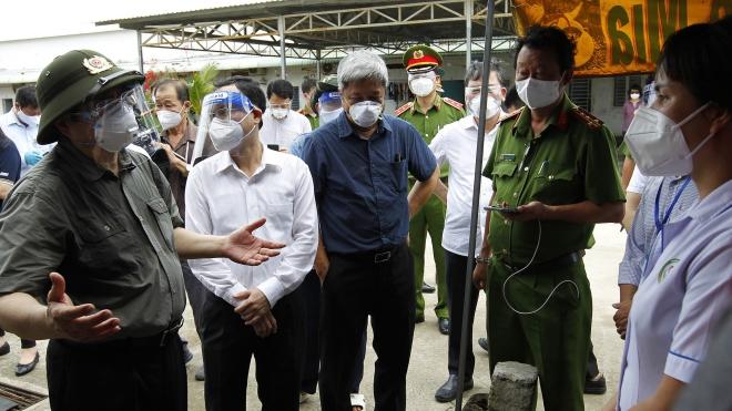Hình ảnh Thủ tướng Phạm Minh Chính thị sát công tác phòng chống dịch Covid-19 tại TP HCM