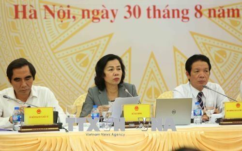 Trong ảnh: Thứ trưởng Bộ Tài chính Vũ Thị Mai (giữa) trả lời câu hỏi của phóng viên. Ảnh: Dương Giang - TTXVN