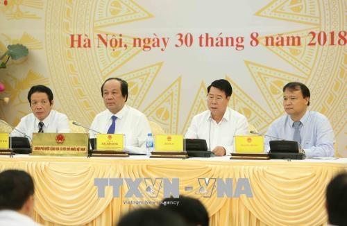 Trong ảnh: Thứ trưởng Bộ Công an Bùi Văn Nam (thứ hai từ phải sang) trả lời câu hỏi của phóng viên. Ảnh: Dương Giang – TTXVN