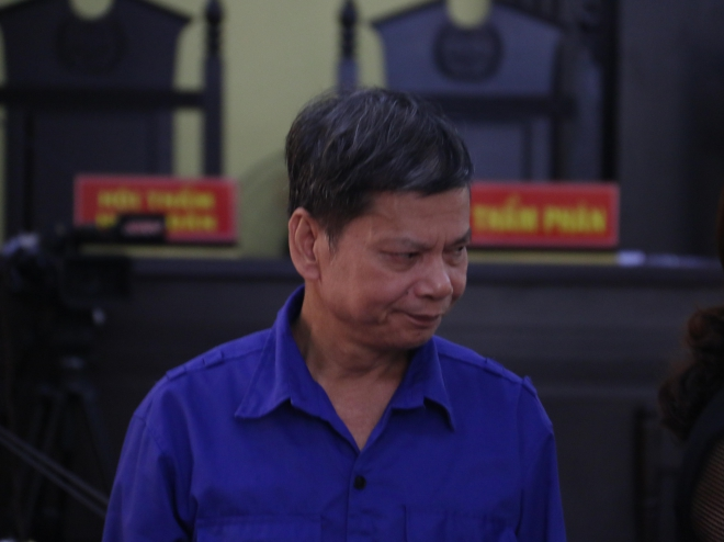 Bị cáo Lò Văn Huynh, nguyên Trưởng Phòng khảo thí và quản lý chất lượng giáo dục, Sở Giáo dục và Đào tạo tỉnh Sơn La tại phiên tòa. Ảnh: Hữu Quyết - TTXVN
