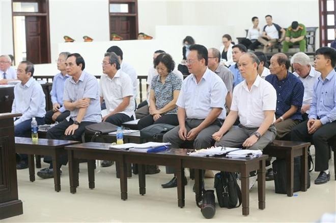 Trong ảnh: Các bị cáo tại phiên tòa. Ảnh: Doãn Tấn - TTXVN