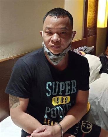 Trong ảnh: Đối tượng Gao Liang Gu (Cao Lượng Cố) khi bị bắt giữ. Ảnh: TTXVN phát