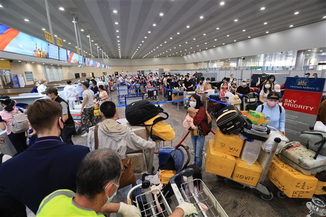Trong ảnh: Hãng hàng không Việt Nam tổ chức chuyến bay đặc biệt thứ hai đưa hơn 280 công dân Việt Nam từ Nga về nước. Ảnh: Trần Hiếu - Pv TTXVN tại LB Nga