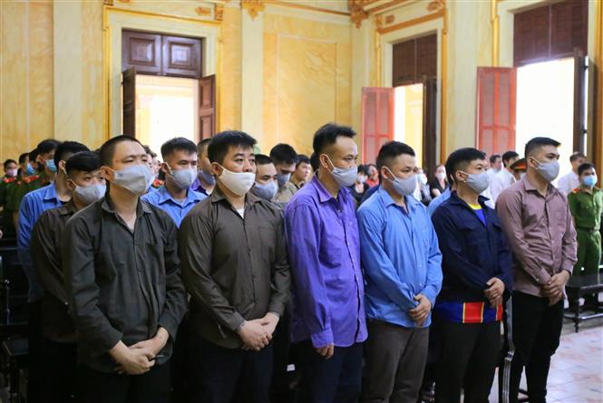 Trong ảnh: Các bị cáo nghe tuyên án ngày 16/12/2020. Ảnh: Thành Chung - TTXVN