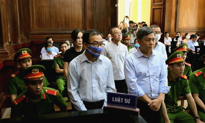 Các bị cáo nghe tuyên án. Ảnh: Thành Chung - TTXVN