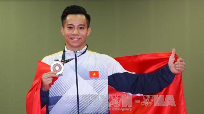 Thanh Tùng là VĐV thứ 2 của Việt Nam chính thức có vé dự Olympic 2020. Ảnh: TTXVN
