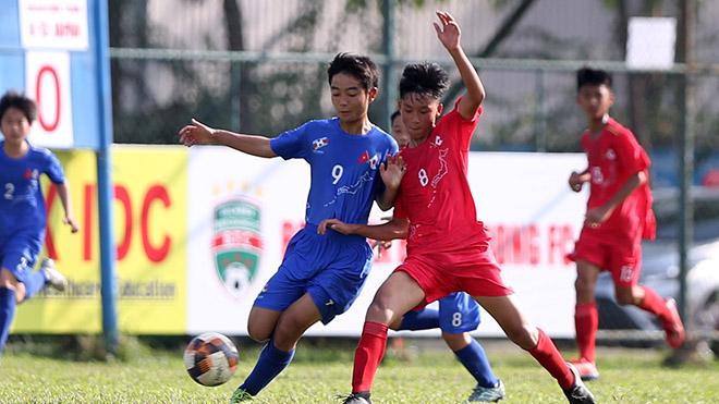 Trận đấu giữa U13 Nhật Bản (xanh) và U13 Việt Nam diễn ra rất quyết liệt với phần thắng chung cuộc nghiêng về chủ nhà. Ảnh: Anh Phương
