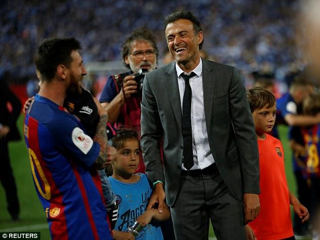 Luis Enrique và Messi lúc vui vẻ bên nhau - Theo Reuters